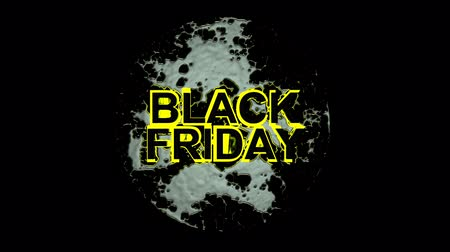 hétfő : Black Friday text with yellow highlight falls from behind camera and hits the floor as it hits a liquid impact is made highlighting the text. Stock mozgókép