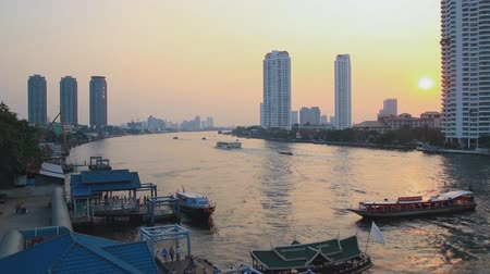 sunset city : Time Lapse, Bangkok city  transport a passenger boat in the river with sunset
