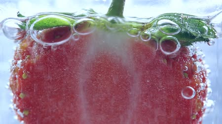 strava : Close up strawberry  in water with bubbles.