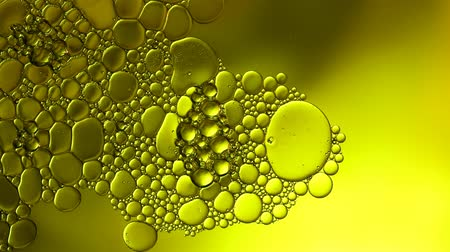 blue and yellow : Air bubbles floating on the surface  the water with a yellow background, Videos HD Stock Footage