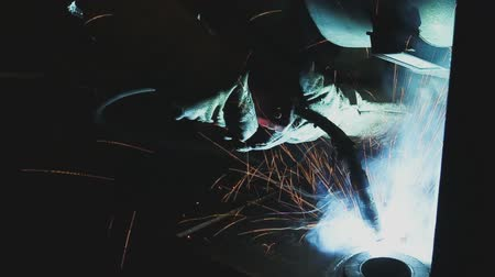 acetylene : Welder of Metal Welding with sparks and smoke in  manufacturing