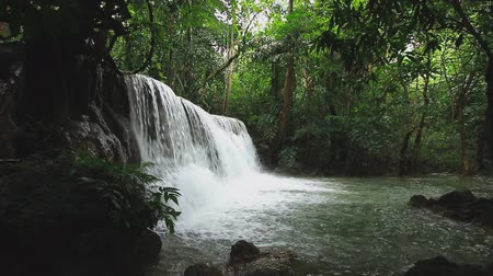 huai : Beautiful Huai Mae Khamin waterfall in the rainy season with green forest ,  Kanchanaburi Province, Thailand