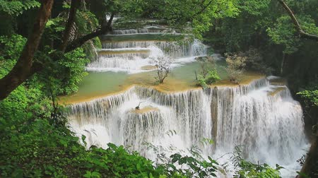 huai : Beautiful Huai Mae Khamin waterfall in the rainy season with green forest, Kanchanaburi Province, Thailand,Video Full HD 1920x1080
