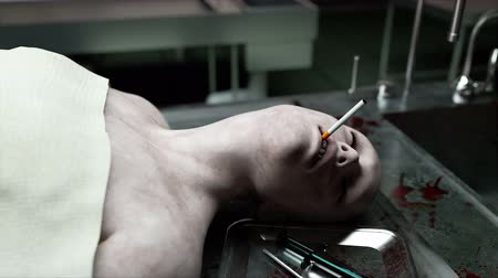 жертва : Smoking kills. dead male body in morgue on steel table. Corpse. Autopsy concept. Стоковые видеозаписи