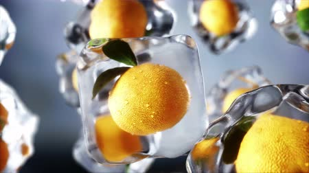 Oranges rotate in ice cubes. Food and broadcast concept. Realistic ice materials. 4K animation.
