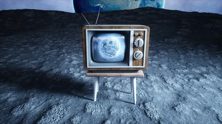 sintonizador : old wooden vintage TV on the moon. Earth background. Space concept. Broadcast. Stock Footage
