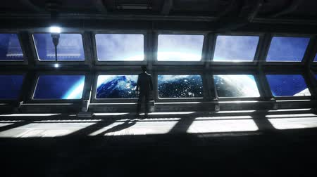 People in futuristic space corridor, room. view of the earth. cinematic 4k footage.