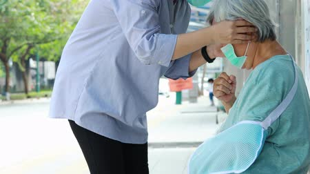 tosse : Asian female daughter is care, help, wearing face mask protection for senior mother,woman and elderly with medical mask because of air pollution,spread of germ,Coronavirus,Wuhan Corona virus 2019-nCoV Stock Footage