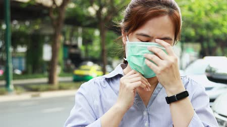 respiratory infection : Asian female people showing how to use hygienic mask, step by step instruction, woman wearing medical face mask on street in city, air pollution protection, allergy to dust,PM2.5, health care concept