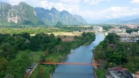 ラオス : High view of the Nam Song and the Orange Bridge. See beautiful mountain views from Vang Vieng, Laos.