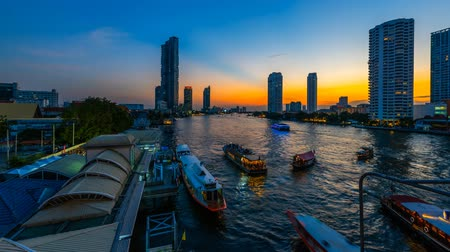 shangri la : Time lapse 4k Day to night. Bussy traffic at Saphan Taksin pier Bangkok Thailand
