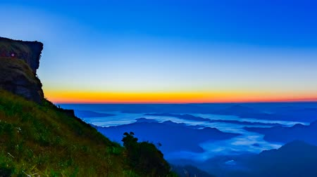 поход : Sunrise scene with the peak of mountain at Phu chi fa in Chiangrai,Thailand Стоковые видеозаписи