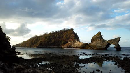 erodida : Atuh beach.The beach is beautiful,the rock are water eroded at Bali,Indonesia Stock Footage