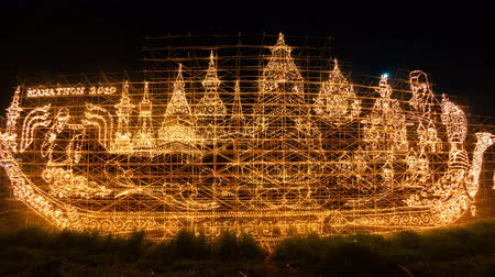 lampa naftowa : Time lapse of Lighting a picture about the local culture and Thai monarchy. In the flow festival of the steamer of Nakhon Phanom province, Thailand