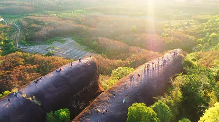 gigantikus : Tourists come to watch the sunrise at 3 Whales Rock in Bueng Kan Province, Thailand Stock mozgókép