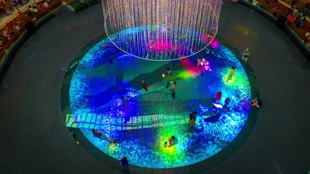 plac zabaw : SINGAPORE-JANUARY 27,2020 :Children run around in the Digital Light Canvas in Singapore. The Digital Light Canvas display is an interactive art installation at Shoppes at Marina Bay Sands.