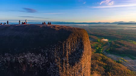 gigantikus : Time lapse of Tourists come to watch the sunrise at 3 Whales Rock in Bueng Kan Province, Thailand Stock mozgókép