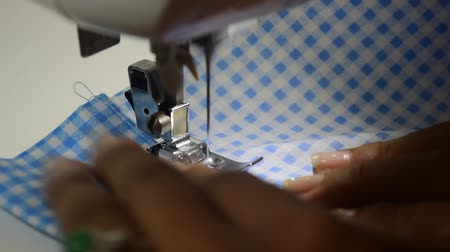 woman are working hobbies at home on sewing machine.