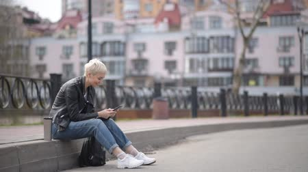 girl sitting on the street