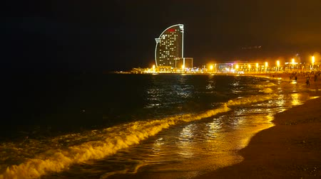 Каталония : Night view of Barceloneta Beach in Barcelona, Catalonia, Spain Стоковые видеозаписи