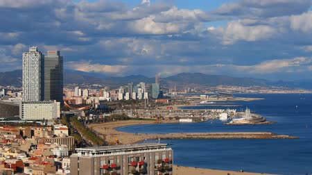 Каталония : Aerial view of Barceloneta Beach and cityscape of Barcelona, Catalonia, Spain Стоковые видеозаписи