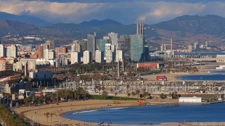 Барселона : Aerial view of Barceloneta Beach and cityscape of Barcelona, Catalonia, Spain Стоковые видеозаписи