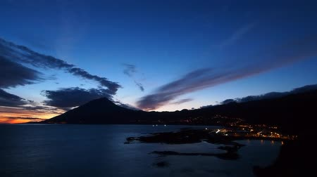azorean : Night view of Lajes do Pico with Pico Mountain in the background, Pico Island, Azores, Portugal Stock Footage