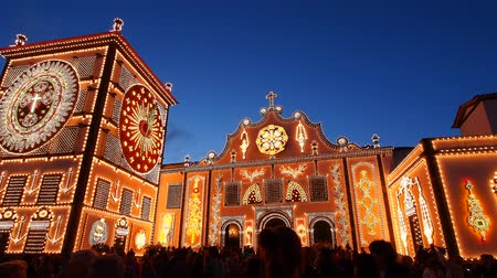 azorean : The illuminated Campo de São Francisco and Convent of Nossa Senhora da Esperanca  during the Holy Christ festivities at Ponta Delgada, Sao Miguel, Azores Islands, Portugal  Stock Footage
