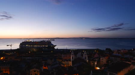 miradouro : Portugal, Lisbon, Miradouro das Portas do Sol, Twilight view over Alfama Neighbourhood towards the Tagus River.