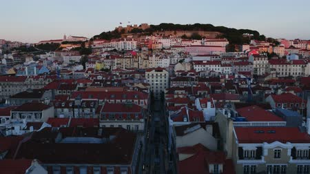 miradouro : Portugal, Lisbon, Miradouro de Santa Justa, View over downtown and Santa Justa Street towards the castle hill at sunset.