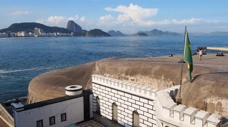 rio de janeiro state : Brazil, City of Rio de Janeiro, View of the Fort Copacabana with the Sugarloaf Mountain on the horizon. Stock Footage