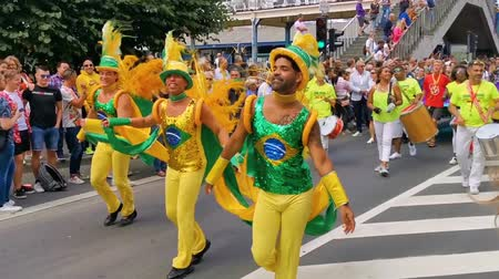 gurur : Brazilian male dancers dancing to the drums, LGBT parade antwerp, Antwerp, Belgium, August 10, 2019 Stok Video