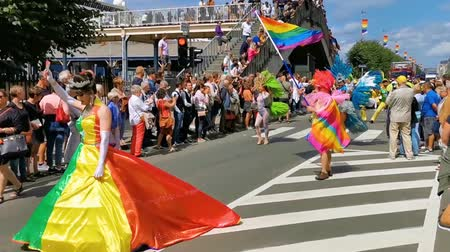королева : beautiful drag queen walking and waving in a colorful dress, LGBT pride parade antwerp, 6 August, 2019, Antwerp, Belgium