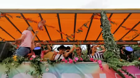arrasto : party truck driving by full with people partying during the antwerp gay pride parade, Flemish LGBT festival, 6 August, 2019, antwerpen, Belgium
