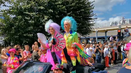 dragging : funny and beautiful drag queens with fans waving and driving by in a car, LGBT pride parade antwerp, 10 August, 2019, Antwerp, Belgium Stock Footage