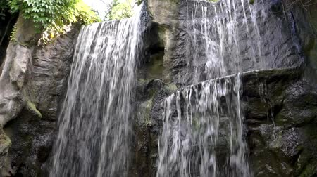 Beautiful waterfalls streaming or big rock cliffs, Nature background Vídeos