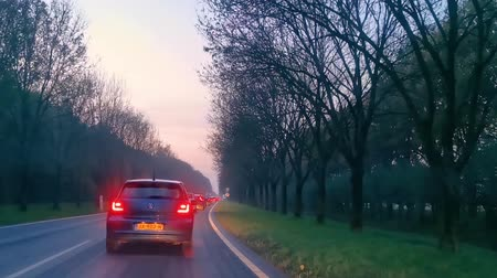hurry up : slow driving in a traffic jam in the lake, Utrecht, the netherlands, built-up area with busy road during rush time, November 20, 2019 Stock Footage