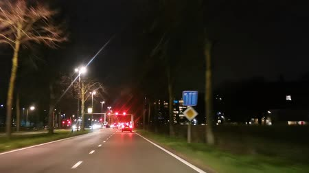 hurry up : Roads with traffic lights in tilburg city, The Netherlands, December 10, 2019 Stock Footage