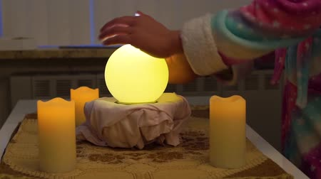 psicodélico : person moving hands around a lighted fortune teller sphere, traditional spirituality and witchcraft