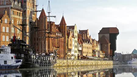 half timbered : Hanseatic port city Gdansk with coastal buildings in style Fachwerk. Poland. Bridge by Green Gate on embankment of river Stara Motlawa. Ferry terminal, Port Crane, branch of National Maritime Museum Stock Footage