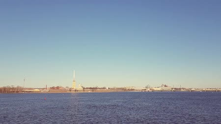 sobor : View from the Palace bridge in St. Petersburg on Hare island with Peter and Paul fortress and spire of Peter and Paul Cathedral. Clear autumn day in cultural Capital of Russia on the Neva river