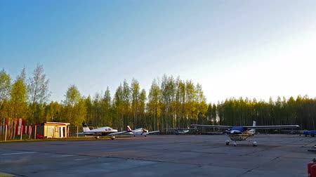 landing field : Kronshtadt, Russia - 12 may, 2018: Light passenger planes parked at a private airport, Kronshtadt, St. Petersburg, Russia. Industrial and civil air transportation by airplane