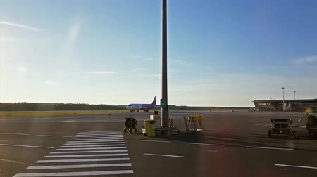aircrew : Riga, Latvia - 27 may, 2018: Wizz Air plane travels through the international airport Riga to arrival terminal. Wizzair is budget airline with largest fleet in Hungary, serving more than 30 countries