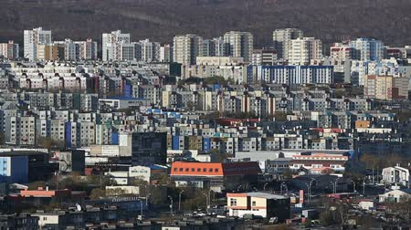 çok katlı : Architecture of the Petropavlovsk-Kamchatsky City - view of an array of new modern multistorey buildings and old houses (evening soft lighting). Kamchatka Peninsula, Russian Far East, Eurasia.