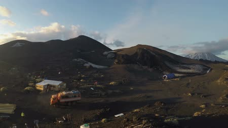 eurasia : Summer touristic camping on a slag field near a cinder cone Claw on Tolbachik Dale, foot of Tolbachik Volcano. Kamchatka Peninsula, Klyuchevskaya Group of Volcanoes, Russian Far East. (Time lapse.) Stock Footage