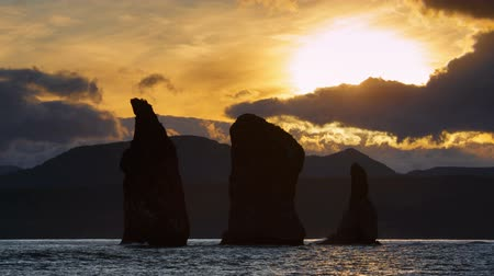petropavlovsk : Kamchatka Peninsula seascape: rocky islands in the sea at sunset - beautiful view of Three Brothers Rocks in Avacha Bay (Avachinskaya Bay) in Pacific Ocean. Eurasia, Russian Far East, Kamchatka Region.