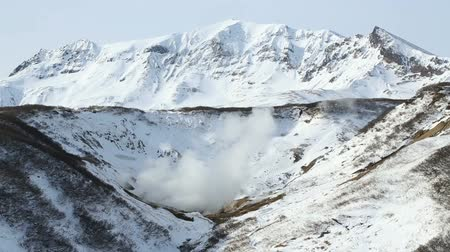 volcanology : Volcano landscape of Kamchatka Peninsula: scenery winter view of geothermal valley of Dachnye Hot Springs - a popular touristic attraction in the volcanic zone of the active Mutnovsky Volcano on Russian Far East.
