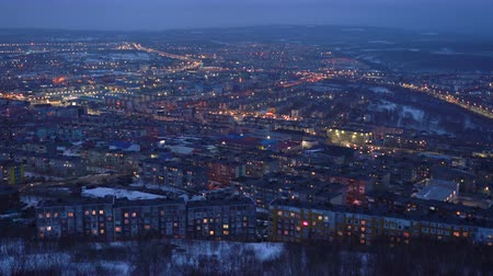night scape : Night top view of residential buildings and illuminated city roads in Petropavlovsk-Kamchatsky City. Eurasia, Russian Far East, Kamchatka Peninsula.