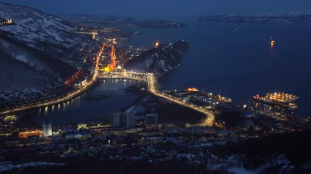 time laps : Night top view of the center of Petropavlovsk Kamchatsky City, seaport located on the mountainous coast of Pacific Ocean (time laps)