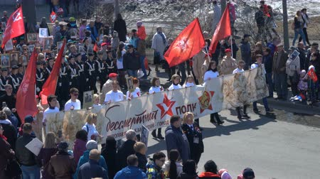 procession : PETROPAVLOVSK KAMCHATSKY CITY, KAMCHATKA PENINSULA, RUSSIA - MAY 9, 2018: Russian Action Immortal Regiment event in the military uniform of the Great Patriotic War marching along city street.